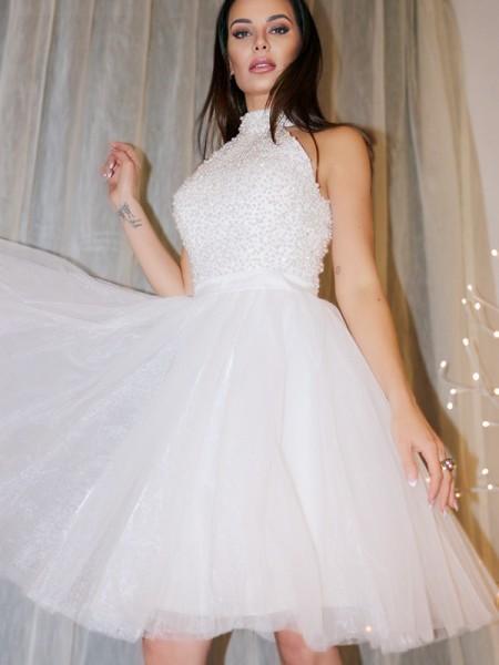 A-Line/Princess Sleeveless Halter Beading Tulle Short/Mini Homecoming Dresses